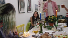 Stock Video Footage of Couples celebrating one of their friend's birthday at dining table