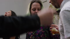 Friends dancing on music at birthday party Stock Footage