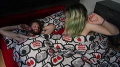 Stock Video Footage of Young couple romancing on bed