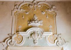 The ornament of a fireplace hood in a neo classical villa. - stock photo