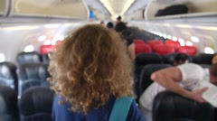 Interior of Airplane with Passengers Looking for Seats - stock footage