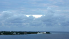 Time lapse- Clouds moving along with point of land at Grand Cayman harbor Stock Footage