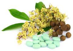 Herbal pills with henna - stock photo