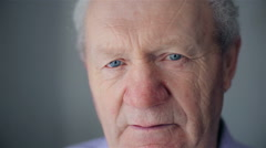 Old man face part closeup eyes looks at camera - stock footage