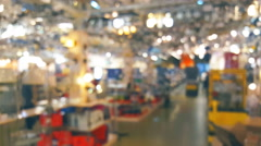 Blurred lights background people in the store fixtures and chandeliers Stock Footage