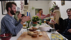 Friends and couples engaged in conversation at a dinner party Stock Footage