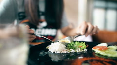 Young woman having lunch in restaurant cafe. - stock footage