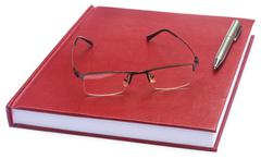 Maroon colored thesis paper - stock photo