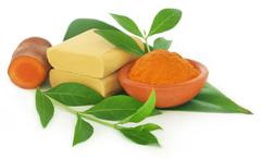 Turmeric with over beautification products - stock photo