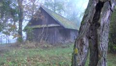 Old desolate wooden building in rural area Stock Footage