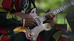 African Man Plays Lead Guitar CU Stock Footage
