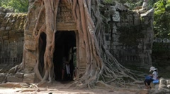 Souvenir seller at overgrown gate at Ta Som temple ,Siem Reap,Cambodia Stock Footage