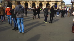 People walking along in front of the opera house in Paris. Stock Footage