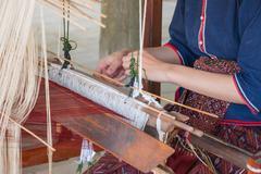 Local asian woman weaving silk in Thailand Stock Photos