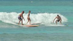 WAIKIKI, HAWAII - CIRCA DECEMBER, People surfing - stock footage