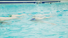 Female synchronized swimmers team train Stock Footage