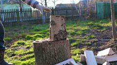 A man chops wood. Sunny Stock Footage
