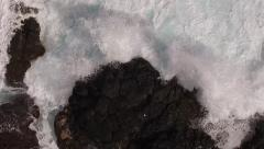Ocean wave crushing on shore rocks from above aerial - stock footage