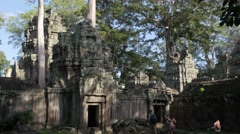 Family with guide enter Ta Prohm temple,Siem Reap,Cambodia - stock footage