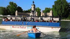 Tourists on boats at Parque de Retiro in Madrid, Spain Stock Footage