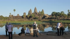 Tourists making photo at pool with reflection on Angkor Wat,Siem Reap,Cambodia Stock Footage