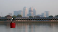 Defocused shot of Canary Wharf with a small padlock Stock Footage