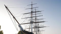 Tilt down the Cutty Sark with Greenwich town in the background Stock Footage