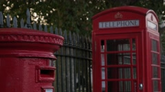 Traditional red telephone box and postbox Stock Footage