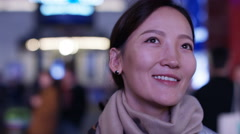 Young asian woman engaged in an electronic display Stock Footage