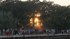 Tourists crowds coming from Angkor Wat temple at sunset,Siem Reap,Cambodia - stock footage
