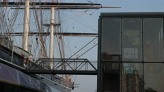 Pan across the Cutty Sark from the  Museum Entrance Stock Footage