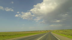 Clouds over the road. The path from Latukhino village - Latukhino village, Stock Footage