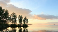 Sunset over the Beloyarsk reservoir. Beloyarsk, Sverdlovsk region, Russia - stock footage