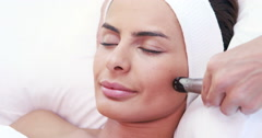 Stock Video Footage of Relaxed brunette having facial treatment