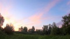 Sunset over the meadow. Krasny Yar, Lubinsky District, Omsk Region, Russia Stock Footage