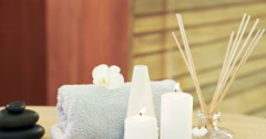 Stock Video Footage of Oil, towel, candles and stones
