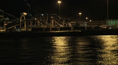 Industrial activity at night harbour Stock Footage