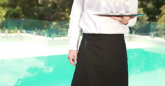Smiling waiter holding champagne glasses Stock Footage