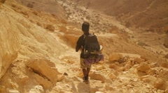 Traveler with Hiking Backpack in the Desert Stock Footage