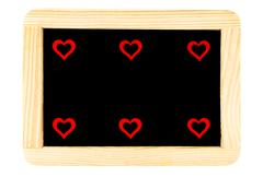 Wooden frame vintage chalkboard isolated on white with six red heart shape sy Kuvituskuvat