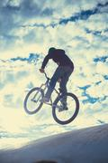 Man riding a bike . Extreme sport, speed, risk. - stock photo