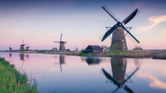 Famous Kinderdijk mills on the water channel. Stock Footage