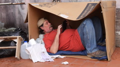 Stock Video Footage of homeless jobless in carton box with tablet computer