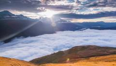 Flowing sea of fog at the foot of the Tetnuldi peak Stock Footage