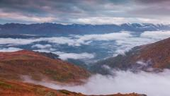 Flowing fog between mountains in autumn morning in the Caucasus mountains - stock footage
