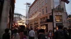 Regent street festive shoppers in London, pan Stock Footage