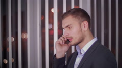 The young businessman speaks by phone Stock Footage
