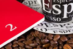 Coffee beans, cup of coffe and diary Stock Photos