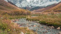 Colorful autumn morning in the Caucasus mountains with a pure mountain creek. - stock footage