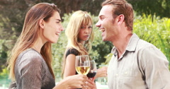 Smiling couple with jealous woman on background - stock footage